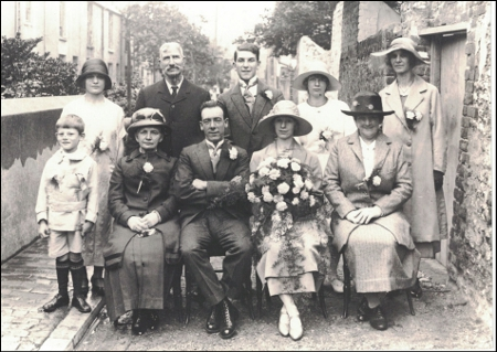 Joseph Wiltshire wearing his wedding best is second from left in the back row. This photo provides a truly remarkable link with a resident of Orange Row from over 150 years ago.