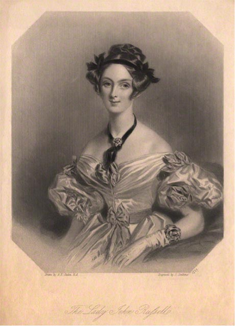 Black and white portrait of a lady wearing a pale silk dress.