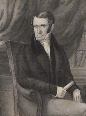 Print portrait of George Faithfull, posed seated, wearing a high collar, dark jacket and holding a paper scroll