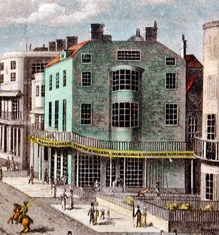 Detail of print showing a four-storey Regency building with balcony,  displaying sign for marine library, bookseller and stationer.